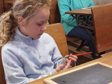 Wessels Farm_girl holding dip pen